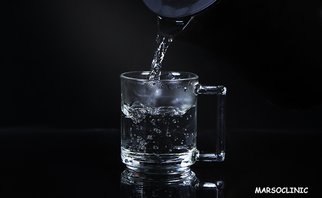 does drinking hot water reduce fat
