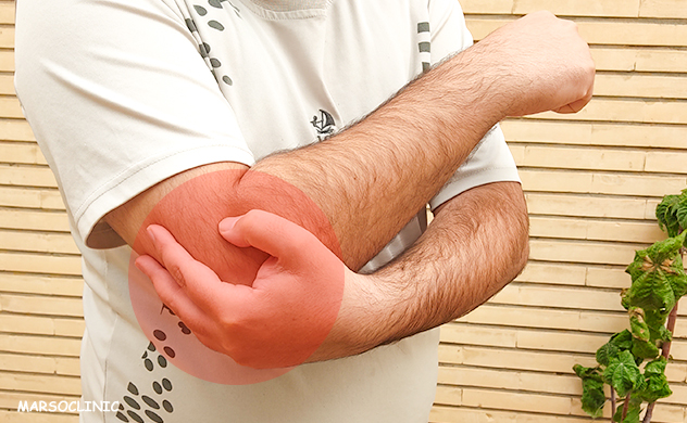 sharp pain in elbow when putting pressure on it
